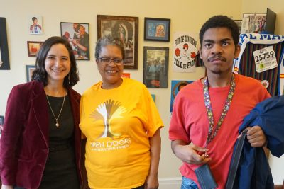 Image description: Image of Parent and Self-Advocate with State Senator Rebecca Saldana standing in an office. Picture taken at Investing in Student Potential Advocacy Day in Olympia.